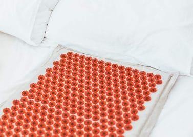 Tout savoir sur l'acupression et l'utilisation d'un tapis champs de fleurs